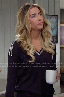 Steffy's black v-neck sweater with silver trim on The Bold and the Beautiful