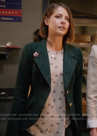 Thea's medallion dotted top and green checked blazer with leather elbows on Arrow