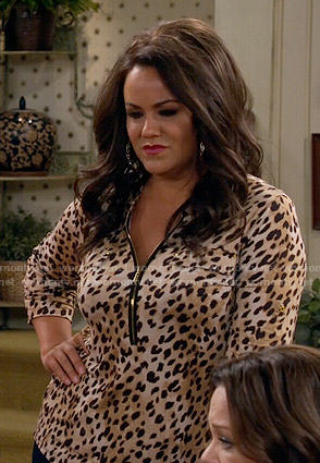 Victoria's leopard print zip neck top on Mike and Molly
