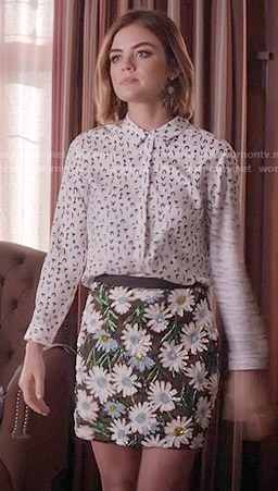 Aria's white symbol print shirt and floral sequin skirt on Pretty Little Liars