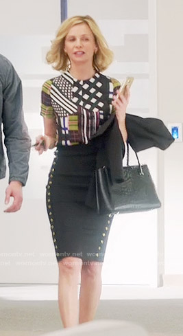 Cat's patchwork print top and black studded skirt on Supergirl