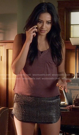 Emily's red striped tank top and studded leather mini skirt on Pretty Little Liars
