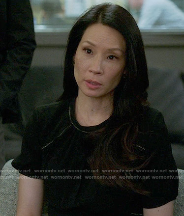 Joan's black short sleeved dress on Elementary