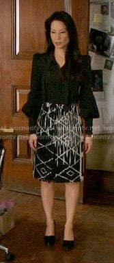 Joan's black and white printed skirt on Elementary
