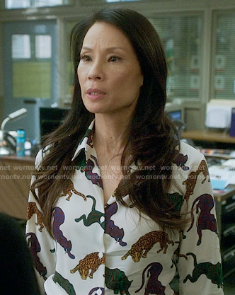 Joan's panther print shirt on Elementary