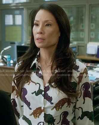 Joan's black short sleeved wrap dress on Elementary