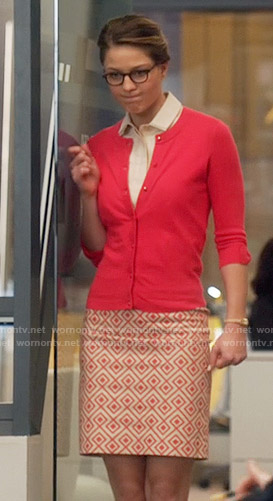 Kara's geometric print skirt and red cardigan on Supergirl