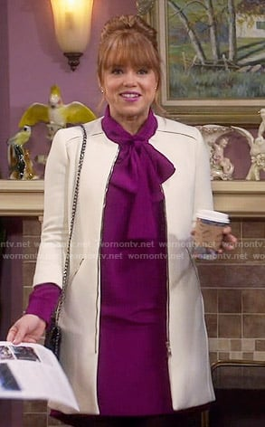 Kristin's pink bow neck dress and white coat on Last Man Standing