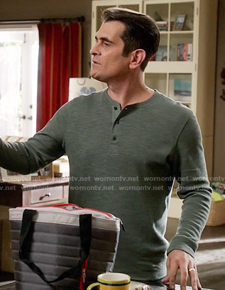 Phil's green henley tee on Modern Family