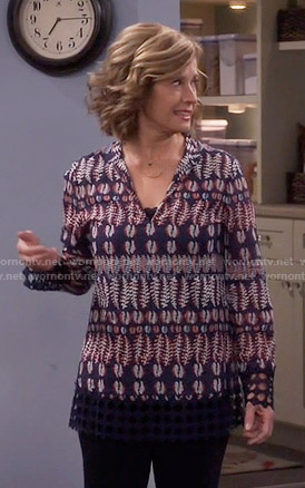 Vanessa's navy feather print top on Last Man Standing