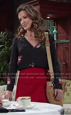 Chelsea's black floral zip-neck blouse on The Young and the Restless