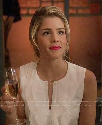 Felicity's white sleeveless ruffled top on Arrow