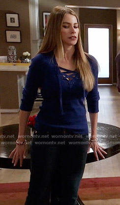 Gloria's blue lace-up sweater on Modern Family
