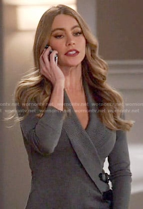 Gloria's grey buckled wrap cardigan on Modern Family