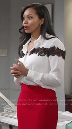Hilary's white blouse with black lace stripe on The Young and the Restless