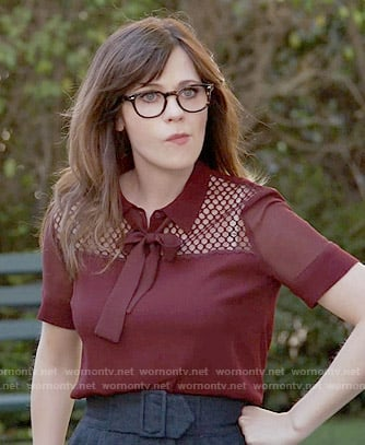 Jess's red tie-neck blouse on New Girl