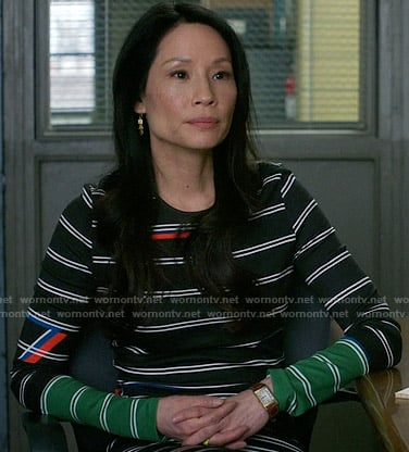 Joan's black striped long sleeve dress on Elementary