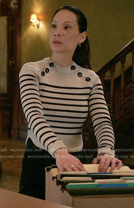 Joan's striped sweater with shoulder buttons on Elementary
