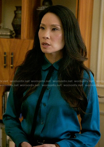 Joan's blue button down shirt with black tie neck on Elementary