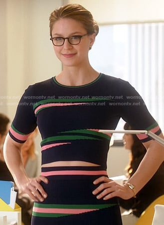 Kara's navy crop top and tube skirt with pink and green pattern on Supergirl