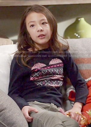 Lily's navy patterned heart sweater on Modern Family