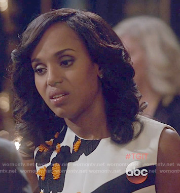 Olivia's black and white dress with orange applique on Scandal