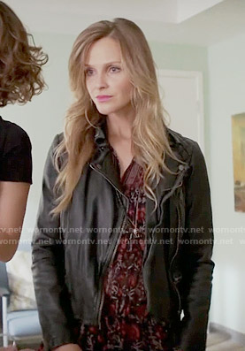 Abby's red printed dress and leather jacket on Girlfriends Guide to Divorce