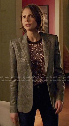 Thea's dotted print top and silver blazer on Arrow