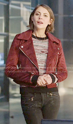 Thea's marled sweater and red suede moto jacket on Arrow