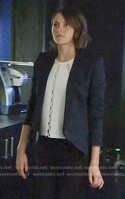 Thea's white cutout inset top and diamond textured blazer on Arrow