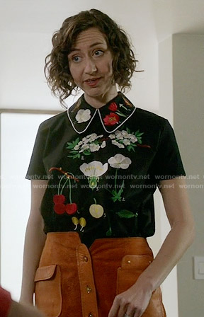 Carol's flower embroidered top and suede button-front skirt on Last Man on Earth