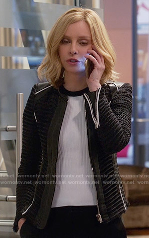 Cat's black textured jacket with white trim on Supergirl