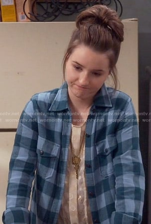 Eve's blue and green checked shirt on Last Man Standing