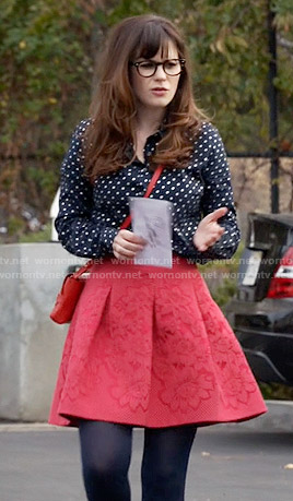 Jess's navy polka dot shirt and red skirt on New Girl