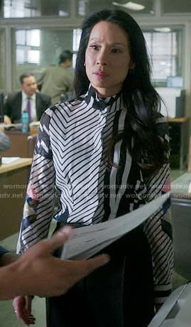 Joan's mixed stripe print shirt on Elementary
