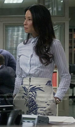 Joan's pineapple print skirt and striped shirt on Elementary