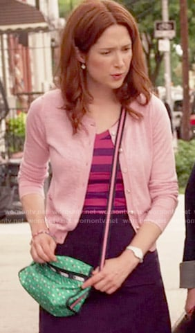 Kimmy's striped top, pink cardigan and green polka dot bag on Unbreakable Kimmy Schmidt