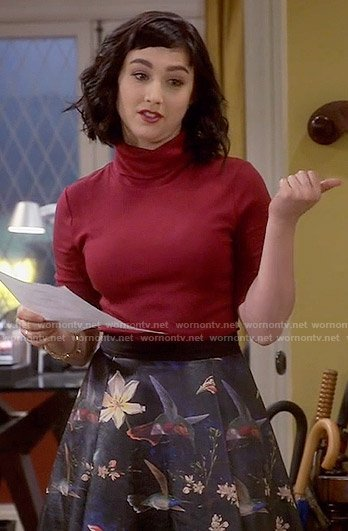 Mandy's floral leather skirt and red top on Last Man Standing