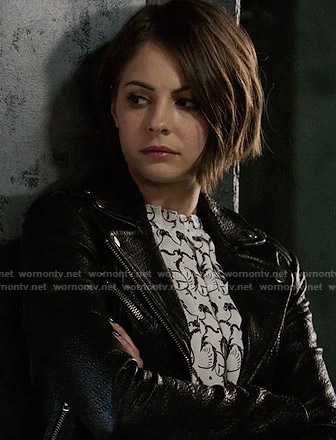 Thea's black and white printed top and leather jacket on Arrow