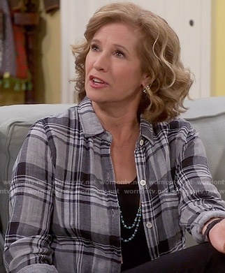Vanessa's grey plaid shirt on Last Man Standing