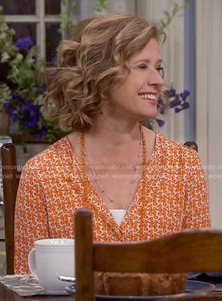 Vanessa's orange seahorse print blouse on Last Man Standing