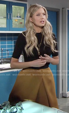 Abby's mustard yellow pleated skirt on The Young and the Restless