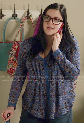 Alex's blue printed v-neck top on Modern Family