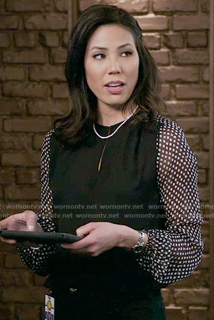 Angela's black blouse with polka dot sleeves on Bones