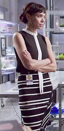 Camille's black top with white tie and striped skirt on Bones