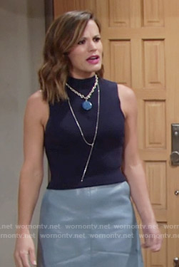 Chelsea's blue leather skirt and navy sleeveless top on The Young and the Restless