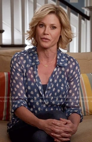 Claire's blue dotted blouse on Modern Family