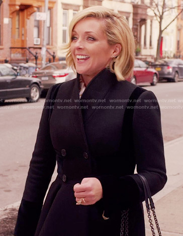 Jacqueline's navy and black coat on Unbreakable Kimmy Schmidt