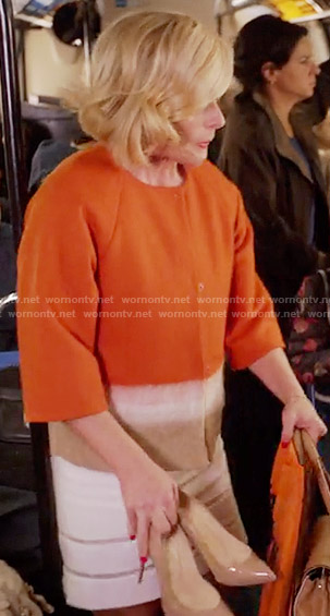 Jacqueline's orange colorblock jacket on Unbreakable Kimmy Schmidt