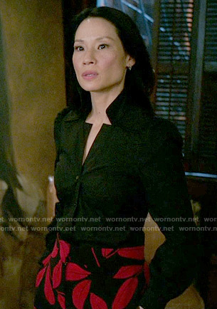 Joan's black and red leaf print trousers on Elementary